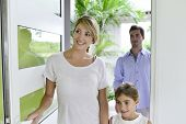 Family of three walking in new home