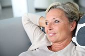 stock photo of stressless  - Portrait of mature attractive woman relaxing at home - JPG
