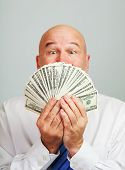 pic of money prize  - Surprised and amazed middle aged man with money - JPG