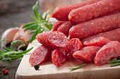 stock photo of peppercorns  - Smoked sausage with rosemary - JPG