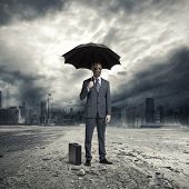 foto of post-apocalypse  - A businessman wearing a gas mask standing in the rain - JPG