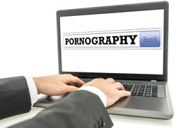 picture of pornography  - Male hands surfing the internet for pornography - JPG
