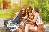 image of beauty parlor  - 3 cute women ice cream parlors while laughing - JPG