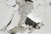 Destruction Of Plaster On Concrete Wall