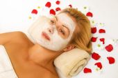 stock photo of face mask  - Beautiful girl relaxing with a face ask on - JPG