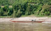 Mekong River Cruise in Laos. Popular tourist adventure trip by slow boat from Huay Xai to Luang Prabang.