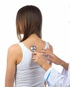 image of auscultation  - Doctor nurse auscultating young patient woman by stethoscope isolated on a white background - JPG