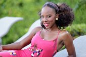 foto of jamaican  - Stock photo of a young Jamaican woman smiling at the camera - JPG