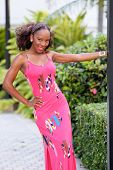 picture of jamaican  - Stock image of a young Jamaican model posing in a pink summer dress - JPG