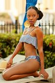 Stock image of a bikini model glancing away