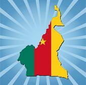 Cameroon map flag on blue sunburst illustration