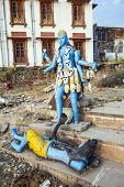 stock photo of shiva  - colorful blue shiva statue at Pushkar lake - JPG