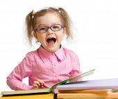 Funny kid girl in glasses with books speaking something isolated on white