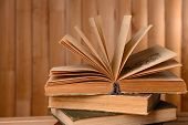 Old books on table on wooden background