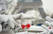 Rare Snowy Day In Paris. Decorated Christmas Tree And The Eiffel Tower
