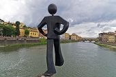 Humorous figure statue of a jumper in front on Ponte Vecchio bridge in Florence