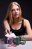Young Woman In Casino Showing Four Aces
