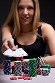 Young Woman In Casino With Four Aces In Hand