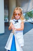 Blond customer girl with shopping bags