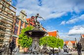 GDANSK, POLAND - 13 MAY: Fountain of the Neptune in old town of Gdansk on 13 May 2014. The bronze st