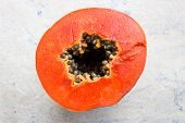 Ripe Orangish colored Papaya on an Isolated background