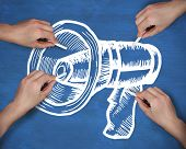 Composite image of multiple hands drawing megaphone with chalk against navy blue