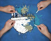 Composite image of multiple hands drawing cityscape with chalk against navy blue