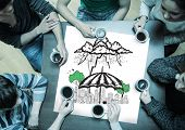 People sitting around table drinking coffee with page showing umbrella sheltering city doodle