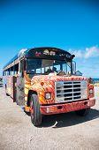 ARUBA, CARIBBEAN - DEC 2013: Picture of colorful bus coach in Aruba, Caribbean on Dec 2013