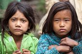 MUKTINAH, NEPAL, NOVEMBER 13 : two little Nepalese girls posing in the  Muktinah village, Annapurna