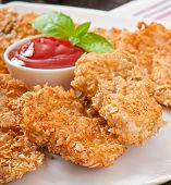 stock photo of southern fried chicken  - Appetizing chicken nuggets breaded and fried in cereals - JPG