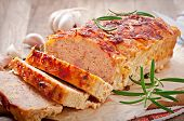 picture of meatloaf  - Homemade ground meatloaf with ketchup and rosemary - JPG