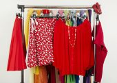 Cute summer red outfits displayed on a rack.