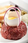 Beef Tartare with Eggs Yolk, Crispy Bread and Spicy Sauce