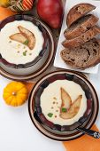 stock photo of parsnips  - Two bowls of hot delicious Roasted Parsnip and Pear Soup - JPG