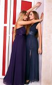 Two Hot Girls In Evening Dresses In Vintage Room