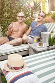 Happy attractive gay couple enjoying a morning outdoors