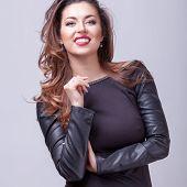 Smilig Brunette Professional Make Up Grey Background