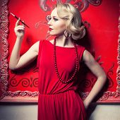 Woman Smoking A Cigarette In Red Vintage Interior