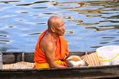 Nonthaburi, Thailand - November 6 : Buddhist Monk Is The Alms On Morning At Sai Noi Floating Market