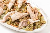 Lebanese cinnamon dusted chicken served on a bed of freekeh fire-dried green wheat with a garnish of toasted nuts.