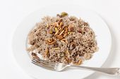 stock photo of ground nut  - Lebanese spiced rice with minced beef and garnished with freshly toasted nuts - JPG