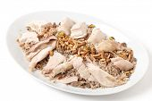 Serving dish of Lebanese chicken and spiced rice with meat and roast nuts, a speciality for celebrations in the Levant