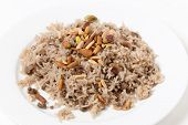 Spiced rice in the Lebanese or Arab style, toped with freshly roasted pine nuts