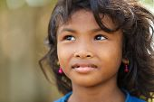 SIEM REAP, CAMBODIA, DECEMBER 04, 2012 : Cambodian little girl in a village near Siem Reap, Cambodia.