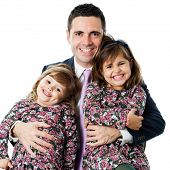 Young Man In Suit Holding His Two Daughters.