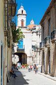 HAVANA,CUBA - NOVEMBER 6,2014 : Street scene in a historic neighborhood near the city cathedral