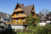 Villa made of wood covered with sloping roofs