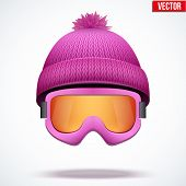 Knitted woolen pink cap with snow goggles. Winter seasonal sport hat. vector illustration