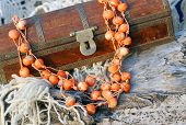 Ethnic Handmade Woodeny Necklace And Old Wooden Chest